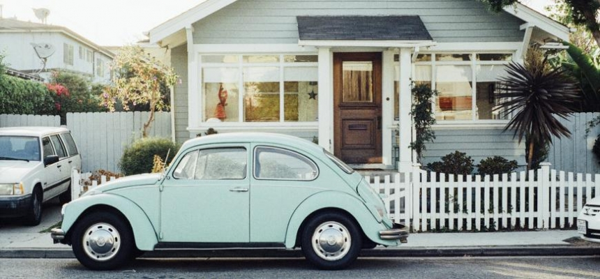 old Volkswagen parked outside house