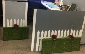 desk with white picket fence hedge flowers