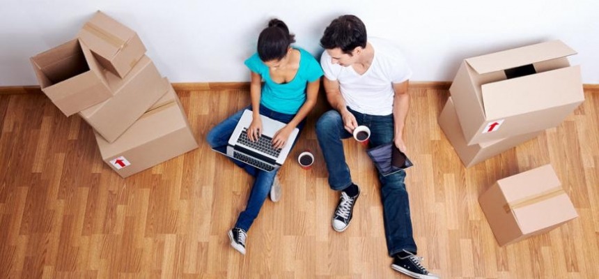 first time homebuyers couple with moving boxes