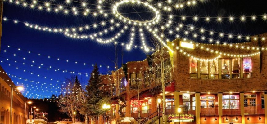 Mountain town at night with string lights