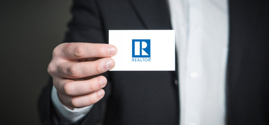 realtor holding business card