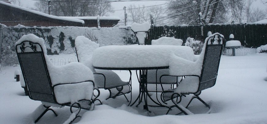 patio furniture covered in snow Colorado winter